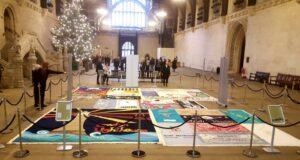 Parliament Hosts Iconic AIDS Quilts 30 Years on From Government Tombstone Adverts